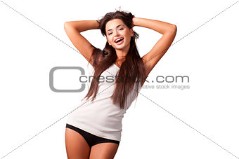Attractive young woman in a white t-shirt on white background