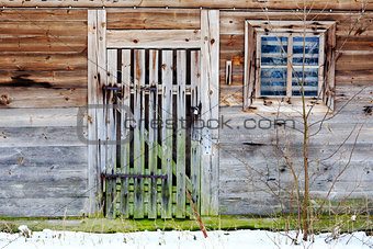 Old door and window of wooden building