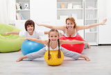 Happy kids exercising with their mother