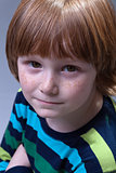 Cute boy with freckles portrait