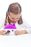 Little girl and her hamster