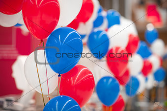 bunch of white, red and blue balloons