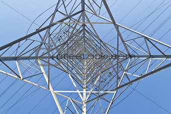 high voltage power tower from below