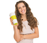 Smiling young woman holding coffee cup