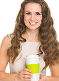 Happy young woman holding coffee cup