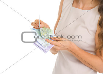 Closeup on woman counting euros