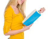 Closeup on student girl reading book