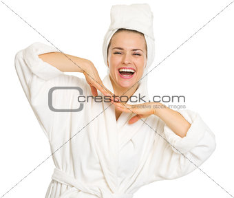 Portrait of happy young woman in bathrobe