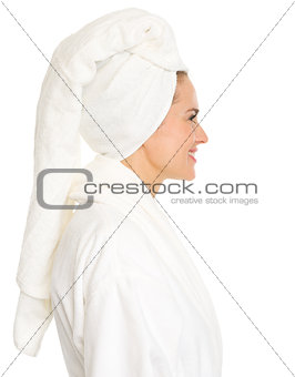 Portrait of young woman in bathrobe in profile