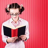 Student Reading Textbook While Learning With Study