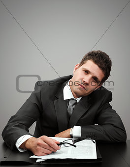Tired businessman at his office