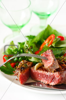 Grilled beef steak and salad.