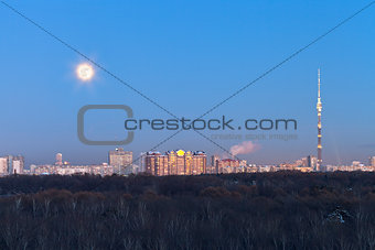 full moon over city