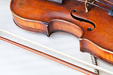 violin sounding board and bow on music book