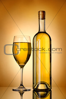 Bottle over gold background