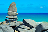 stack of stones on a tropical beach