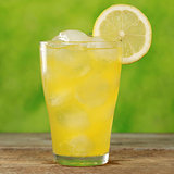 Cold orange lemonade in a glass