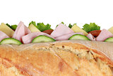 Top view of a baguette with ham