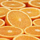 Sliced oranges forming a background