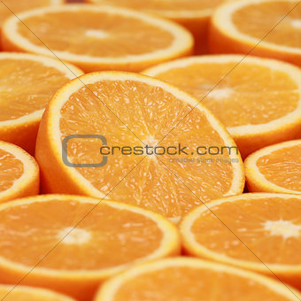 Sliced oranges forming a background