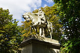 The statue of Louis XIII riding a horse in Place des Vosges, Par