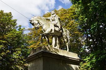 The statue of Louis XIII riding a horse in Place des Vosges, Par