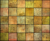 abstract backdrop square tile grunge pattern in orange,yellow an