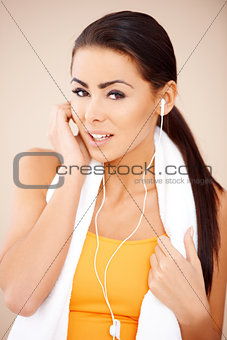 Portrait of sporty woman wearing headphones