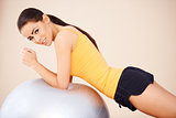 Young happy woman with fitness ball