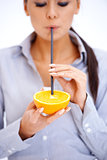 Woman drinks orange juice through a straw