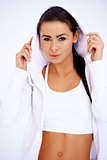 Fit woman wearing hooded sweatshirt