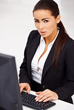 Business woman sitting in front of computer monitor