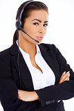 Business woman standing with arms crossed, wearing headset