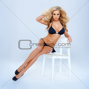 Blonde Woman In Bikini Sitting On Chair
