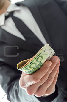 Businessman giving banknotes