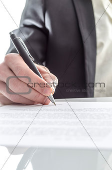 Businessman signing closeup