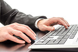 Businessman typing on keyboard