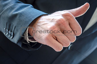Businessman with thumb up sign