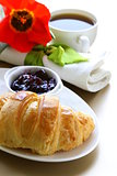 delicious breakfast of fresh puff croissant and cup of coffee