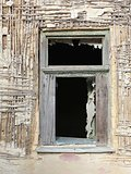 window of a ruined house
