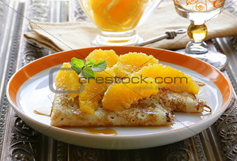 """crêpes suzette"" pancakes with orange and sweet sauce"