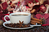 Steaming hot cup of coffee on Christmas background
