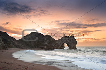 Winter sunrise at Durdle Door on Jurassic Coast in England