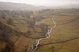Misty morning view along Malham Beck and Dale in Yorkshire Dales