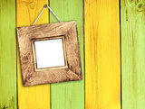 Wooden frame on wooden wall