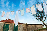 baby clothes on line outside in rural garden