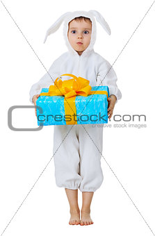 Funny boy dressed as a rabbit with a gift