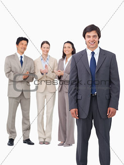 Salesman getting applause from colleagues