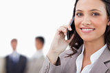 Smiling saleswoman talking on the phone