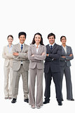 Smiling businessteam standing with arms folded